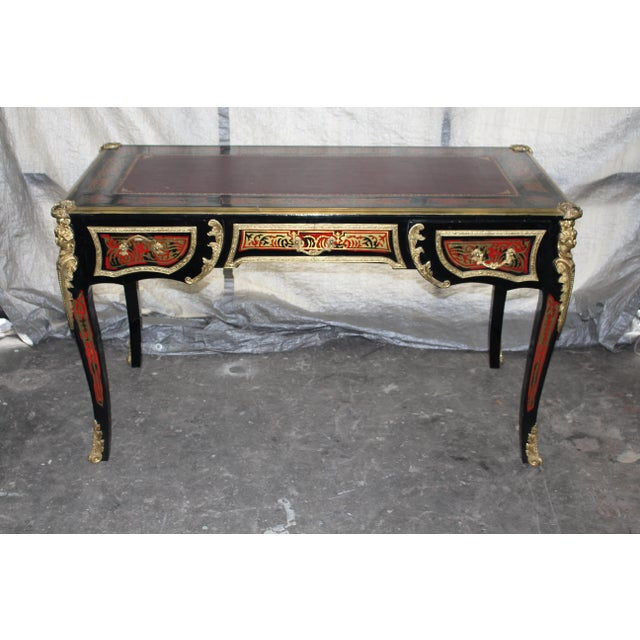Beautiful 19th century Boulle desk. Amazing original detailed work in bronze and red. Black painted French oak wood....
