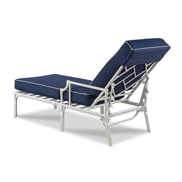 Features a fretwork back and detachable cushions. This chair is made of powder coated aluminum with a weatherproof...