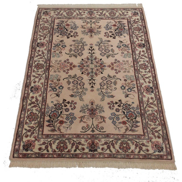 A new, hand-knotted, wool, Persian design area rug. A great piece for the home! Size: 4' x 6' 1""