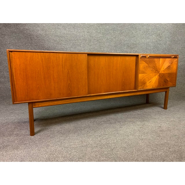 """Here is a beautiful 1960's sideboard in teak wood from the """"Sunburst"""" collection of McIntosh designed in Scotland. This..."""