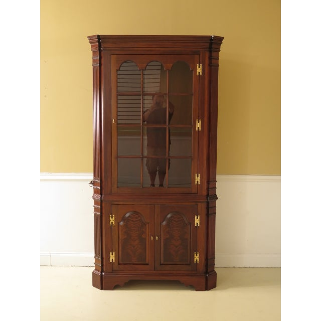 Pair of Councill Craftsmen Chippendale Mahogany Corner Cabinets. They are approx. 10 years old. Includes Mahogany color....