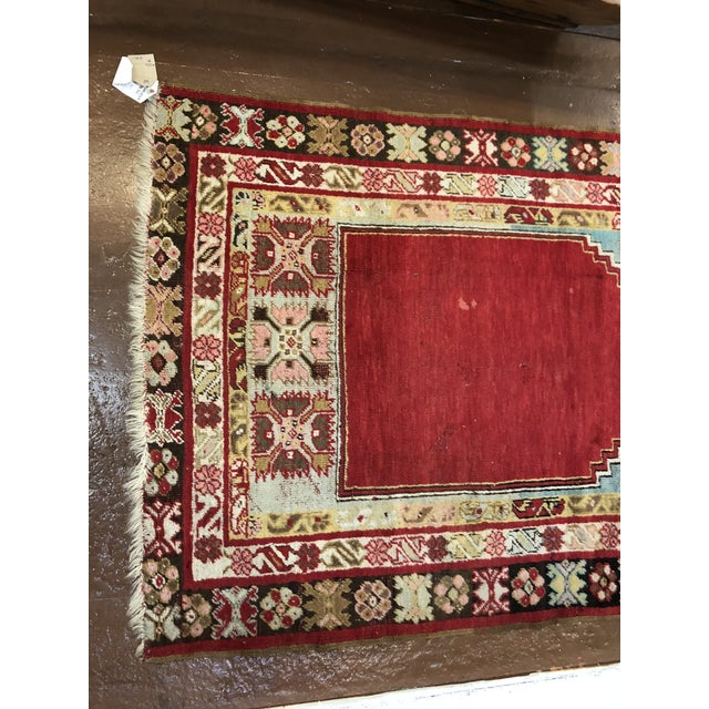 Colorful antique Turkish wool rug