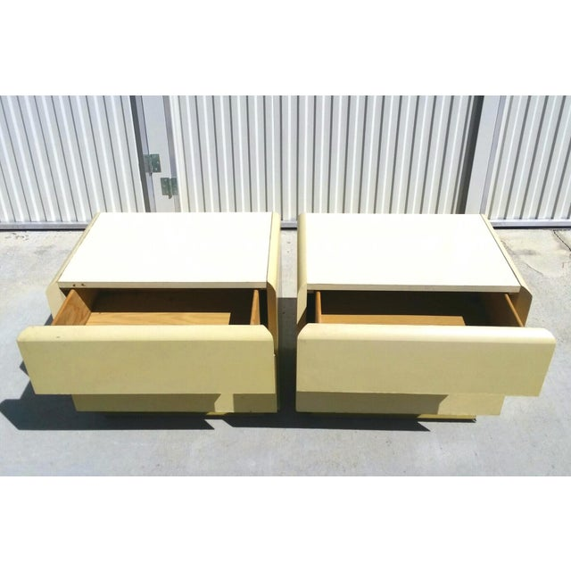 This modernist set of nightstands by Lane Furniture, produced circa 1970's. Each nightstand is finished in yellow lacquer...