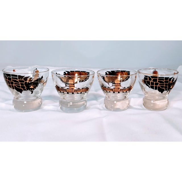 Vintage Capital and United States Map lowball whiskey glasses. Gorgeous detail in gold and black. One side depicts the...