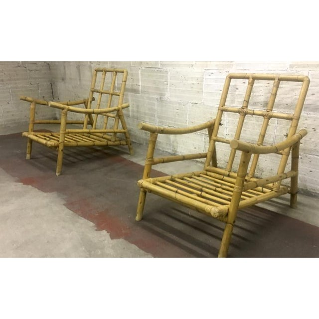 Riviera style Superb pair of bamboo lounge chairs.