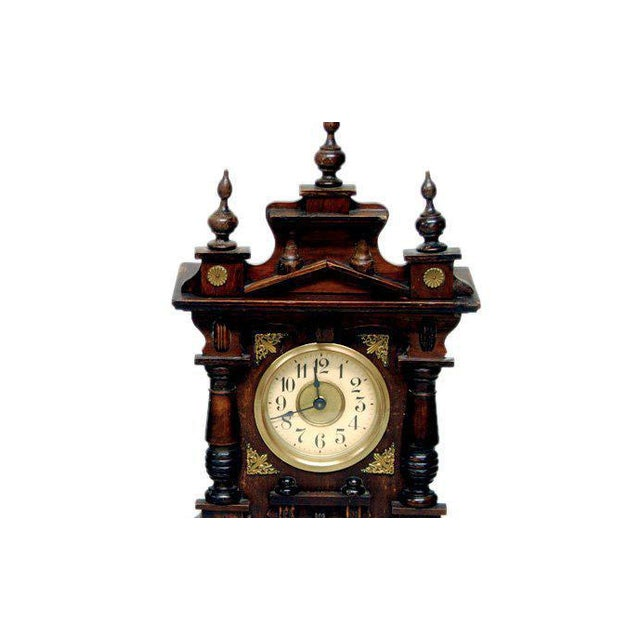 Handsome 19th carved wood shelf clock with musical movement. German