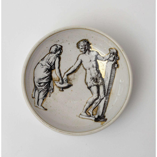 Classical and Roman would elicit the imagery on this signed lovely period Italian Fornasetti porcelain gilded bowl/ dish.
