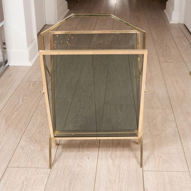 Smoked glass and brass magazine rack.