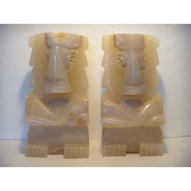 Solid onyx bookends or decorative statues, hand carved in Mexico from solid onyx - each one weighs around 20lbs....