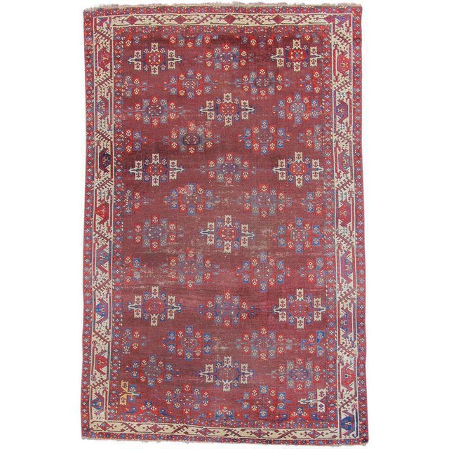 """This Yomut Turkmen main carpets combines spacious drawing with vibrant saturated color. Diagonal rows of """"Kepse guls""""..."""