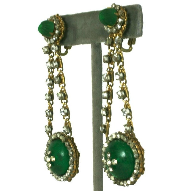 Elegant Miriam Haskell long earrings of frosted cotele faux pate de verre emeralds, round cabochons, and hand sewn crystal...