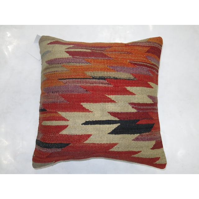 Pillow made from a vintage turkish rug with cotton back. Zipper closure and foam insert provided. 15'' x 16''.
