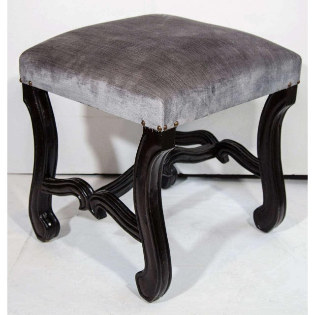 Elegant mid-century vanity stool with hand-carved walnut wood base in ebonized finish. Newly upholstered in luxe grey...