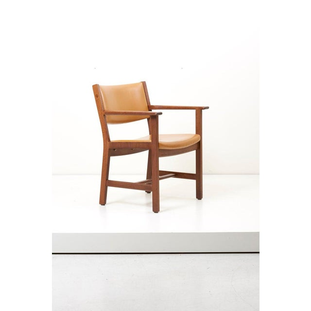 Set of 10 wooden and leather armchairs. Design by Hans Wegner, 1960s. Produced by GETAMA, Denmark. The seat shows wear of...