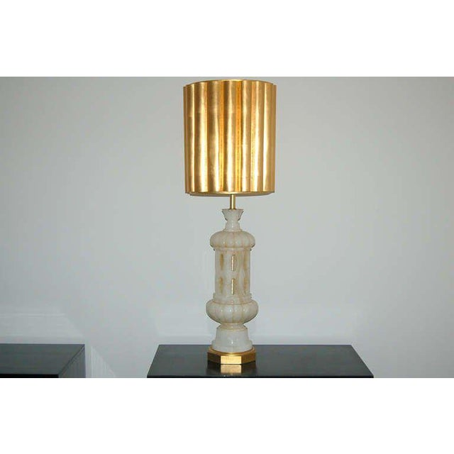 Intricately carved, very tall Italian alabaster table lamp by The Marbro Lamp Company. Gold leaf wood base mirrors the...