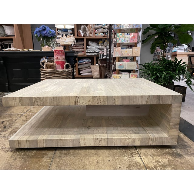 White oak two layer modern cantilever coffee table.Made by Taracea.