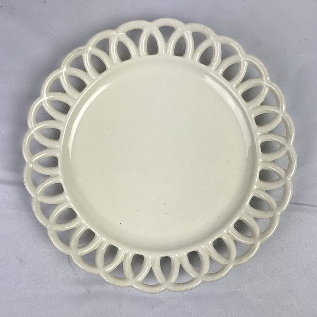 Pair of Swedish 19th c. creamware plates with reticulated loop boarder. Makers mark on underside.