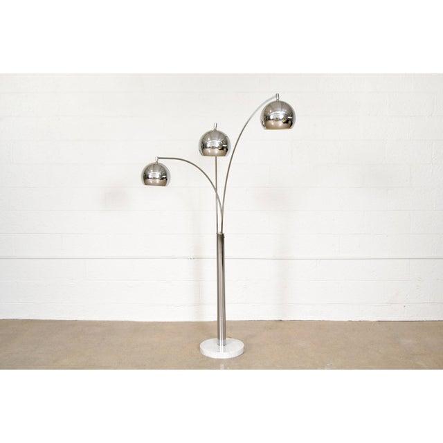 • Vintage mid century modern triple orb arc floor lamp in the style of Castiglioni or Sonneman circa 1970. • Sleek...