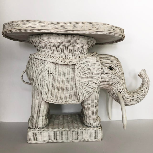 Vintage wicker elephant garden stool/side table. Painted white wicker. Removable tray table top. Great as a occasional...