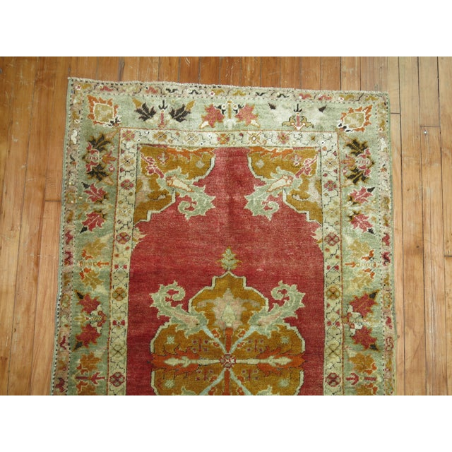 Hand-knotted One of a kind finely woven Antique Turkish Melas rug with medallion and border design. circa 1910-1920