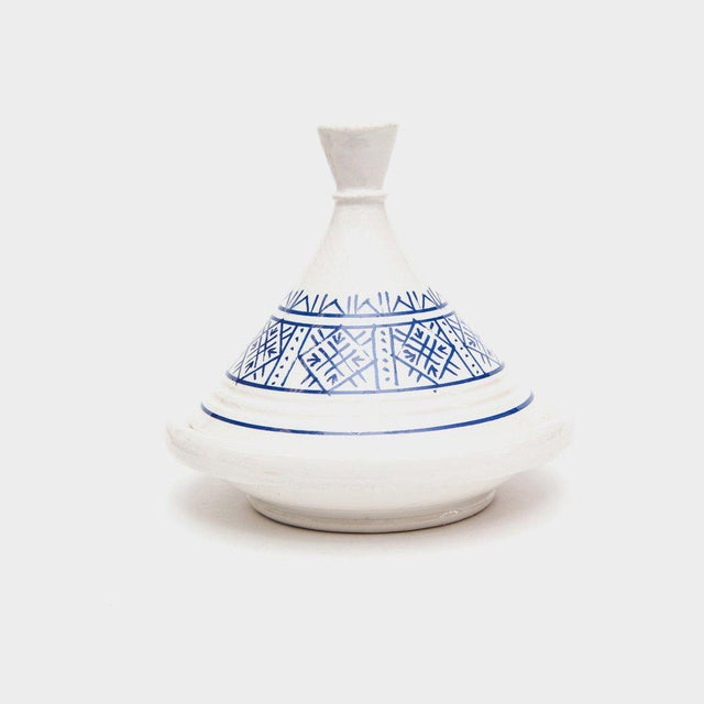 With its signature dome-shaped ceramic lid and low, rounded base, this handcrafted Moroccan tajine pot makes an...