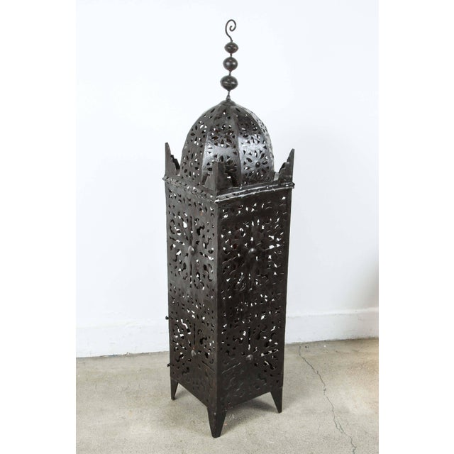 Set of three Large Moroccan metal candle lanterns. Hurricane candle lamp handcrafted in Morocco by artisans, metal hand-...