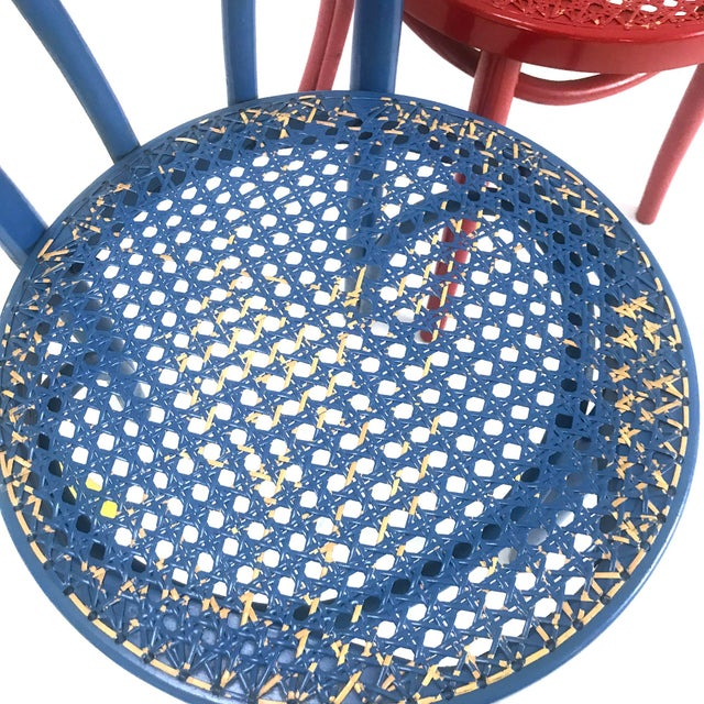 A set of four vintage Radomsko candy cane back chairs from an old cafe. Very colorful and bright -- add an instant dose of...