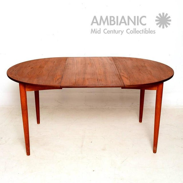 """For your consideration a vintage Danish modern teak dining table. The table has round shape with one extension ( 19 5/8"""" W..."""