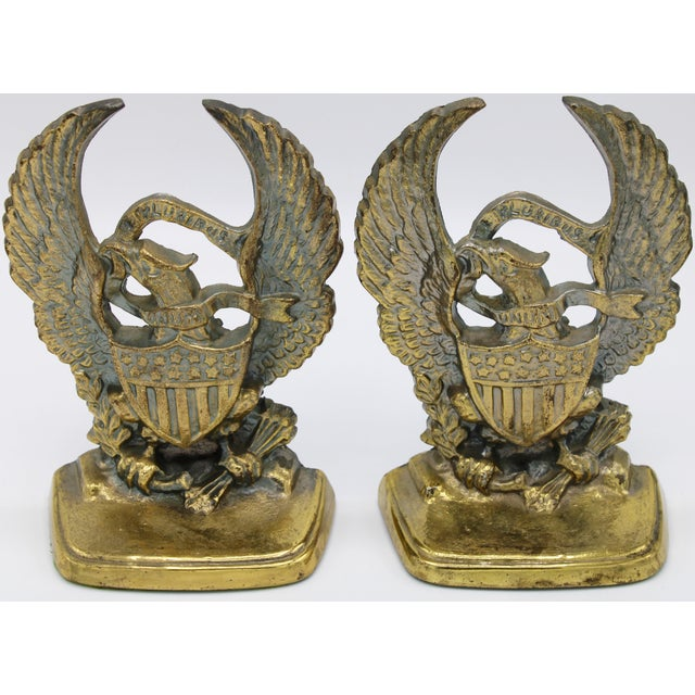 This is a fine pair of Mid-20th Century Cast Iron Federal Eagle Bookends with a gold finish. They are sturdy, and carry a...