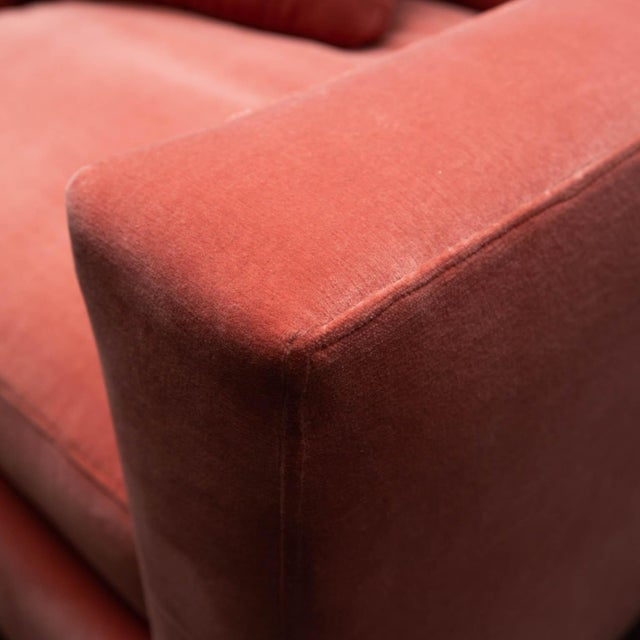 Comfortably sized for Netflix binge watching, this solidly-built club chair is newly reupholstered in salmon colored...