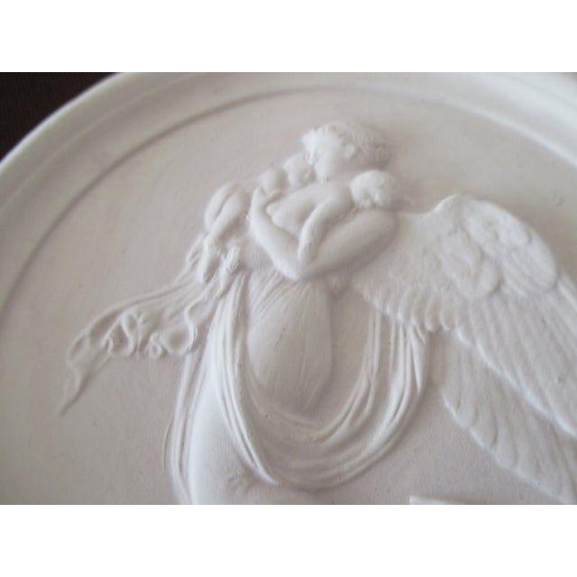 Pair of Vintage Bisque Plaster Intaglios Depicting angels flying with children in their arms Antique white Size: 5.5 x 5.5...