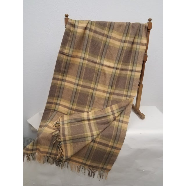 Merino Wool Throw Soft Beige Green Blue Purple Plaid - Made in England A versatile throw in a plaid design made from soft...