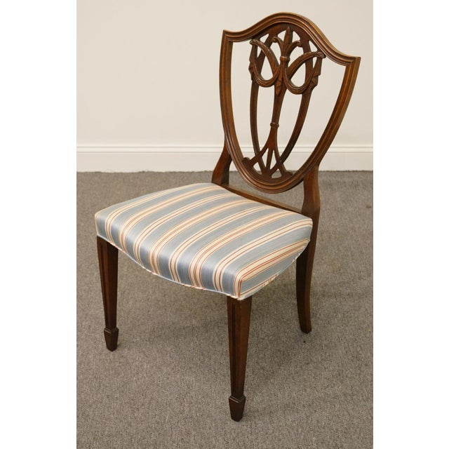 This is a vintage Duncan Phyfe shield back dining chair. The piece is from the 1940s.