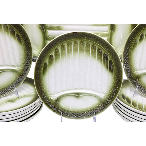 "Mid-Century French majolica asparagus set: one platter, 15""L x 10""W x 1.25""H; thirteen plates, 10""Dia x .75""H. Maker's..."