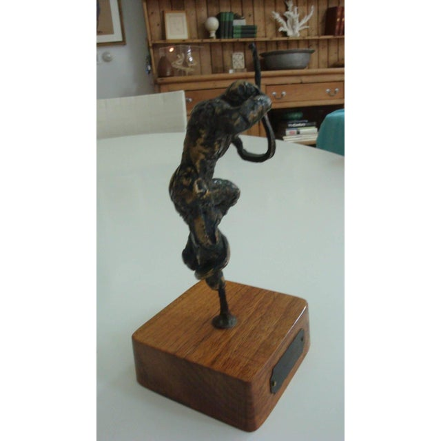 This is a Abbott Pattison Bronze man from 1970s. It is an abstract form that appears to have a rope or snake wrapped...