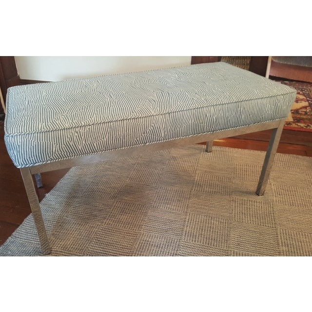 Upholstered bench with chrome legs re-upholstered in Groundworks Avant Blue/White fabric.