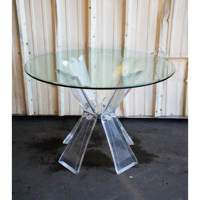 Watch the light dance through the kaleidoscope effect design of this stunning table! This Mid-Century Modern lucite and...