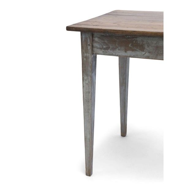 Swedish side table (circa 1840-1860): scrubbed and waxed top raised upon tapered leg base. Mortise and tenon construction....