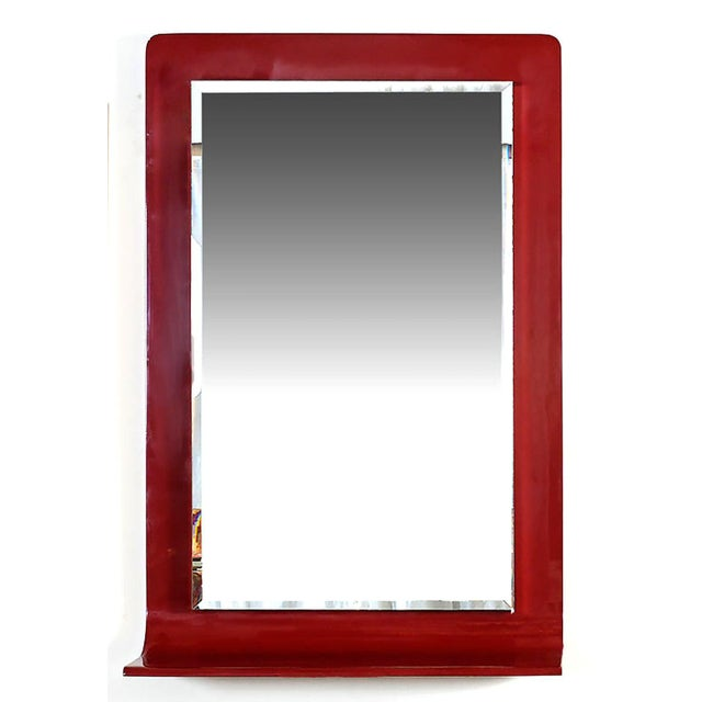 Stunning rectangular lipstick red lacquer mirror by New York maker, Gampel-Stoll. Bottom of wooden frame curves from...