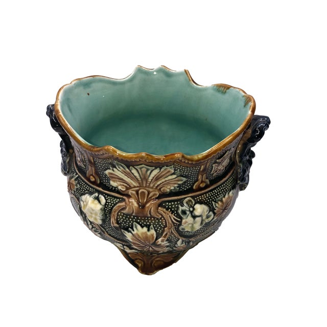 A pair of turn of the century French antique majolica planters with botanical design and green interiors. . Circa 1900,...
