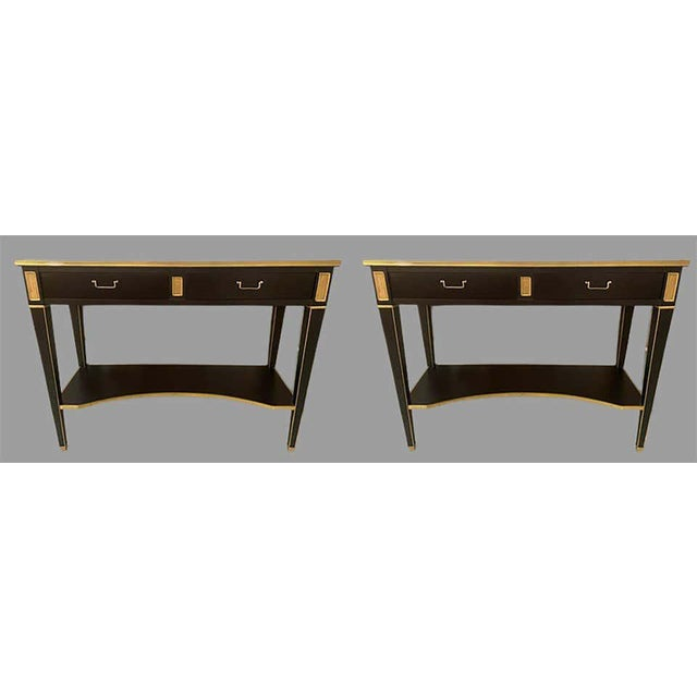 Pair of Hollywood Regency neoclassical ebony console or sofa tables in the manner of Maison Jansen. A stunning sleek and...
