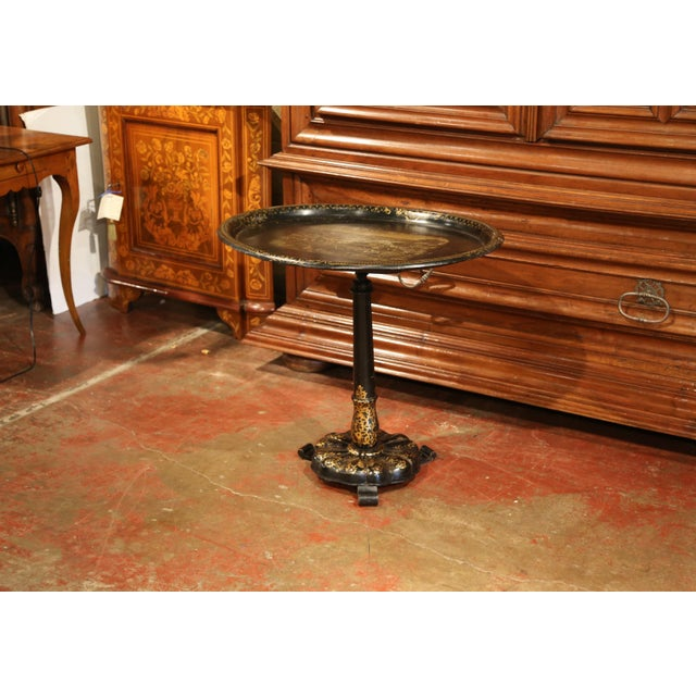 Elegant antique side table from Paris, France; crafted circa 1870, the occasional table features a blackened wooden...