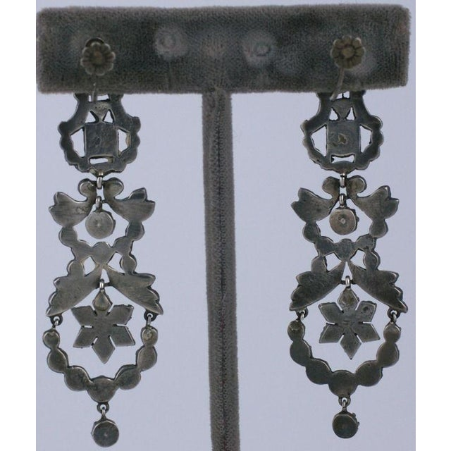 Rare older marcasite earrings frm the late 19th Century set with emerald pastes in sterling. Fully articulated with...