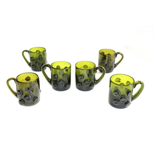 Set of six charming mid century modern handblown glass mugs in beautiful bottle green or dark emerald green. Large...