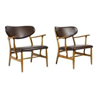 Rare Pair of Hans Wegner CH22 Easy Chairs by Carl Hansen
