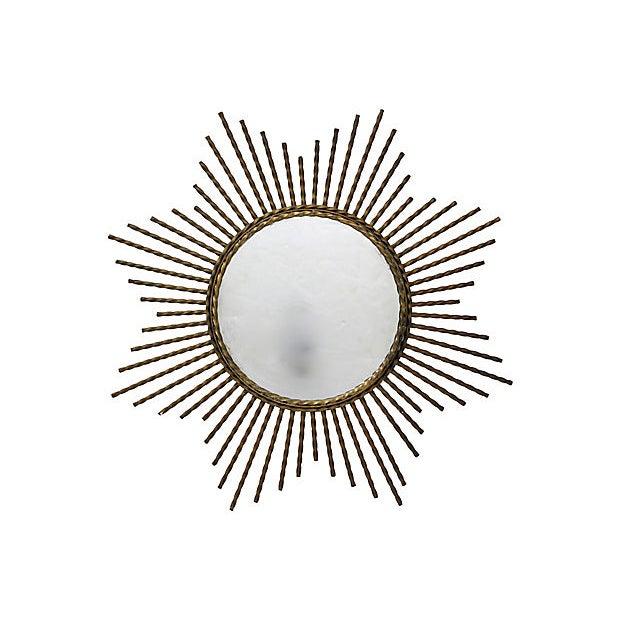Mid-Century heavy iron sunburst mirror from Provence, France. No maker's mark. Light wear.