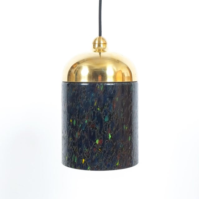 Pair of Murano glass pendants, circa 1970. Featuring thick blue/green colored glass and brass hardware. Restored and newly...