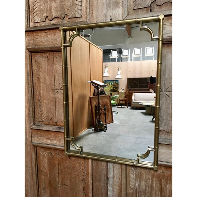 Great size mirror that can be hung in either direction. In solid brass with nice patina.