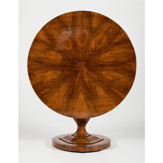 Circular top with wonderfully matched figured top over a shaped vase form support ending on a circular plinth base.