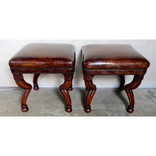 Pair of handsome Gazelle style square benches upholstered in a crocodile style embossed leather and finished with a double...